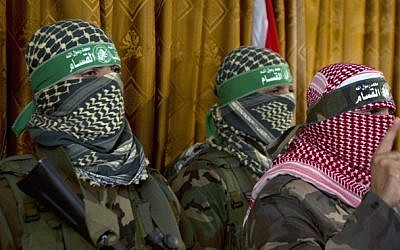 Abu Ubeida (right), the official spokesperson of the Palestinian militant group Izz ad-Din al-Qassam  Brigade, the armed wing of Hamas, at a press conference on July 3, 2014, in Gaza City (photo credit: AFP/Mohammed Abed)