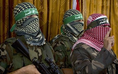 Abu Obeida (right), the official spokesperson of Hamas's military wing the Izz ad-Din al-Qassam  Brigades, at a press conference on July 3, 2014, in Gaza City (AFP/Mohammed Abed)