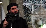 A still from a propaganda video released on July 5, 2014, allegedly shows the leader of the Islamic State jihadist group, Abu Bakr al-Baghdadi, addressing Muslim worshipers at a mosque in the IS-held northern Iraqi city of Mosul. (AFP/HO/al-Furqan Media)