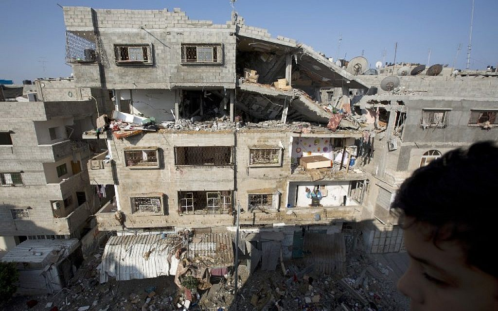 A picture taken in Gaza City on July 10, 2014 shows a damaged building after it was hit by an Israeli air strike. (photo credit: AFP / MOHAMMED ABED)