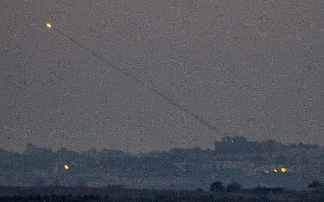 A picture taken from the southern Israeli Gaza border shows a rocket being launched from the Gaza strip into Israel on Thursday, July 10, 2014. (photo credit: Jack Guez/AFP)
