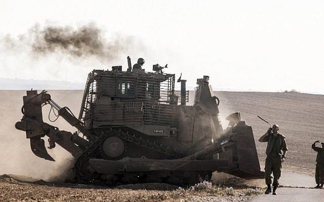 Illustrative. An Israeli D9 bulldozer rolls along the southern Israeli border with the Gaza Strip following Israeli airstrikes on the Gaza Strip on July 10, 2014. (Jack Guez/AFP)