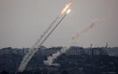 A picture taken from the southern Israel-Gaza border shows a rocket being launched from the Gaza Strip into Israel on Friday, July 11, 2014. (photo credit: Menahem Kahana/AFP)