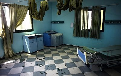 Broken glass in seen in a room of the Al-Wafa rehabilitation hospital near Gaza City on July 16, 2014 following a military strike. (photo credit: AFP/THOMAS COEX)