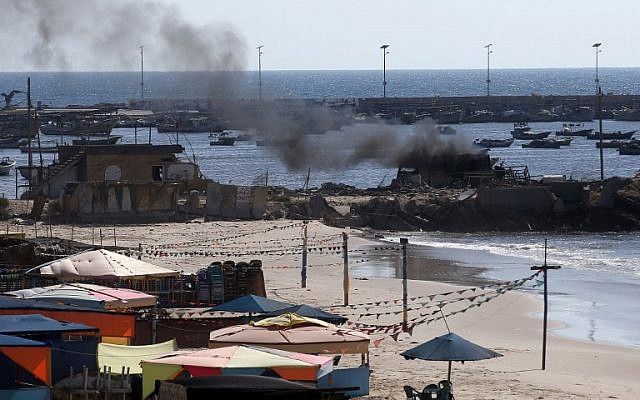 Smoke billows from a beach shack in Gaza City following an IDF strike in which four children were killed, July 16, 2014. (AFP/Thomas Coex)
