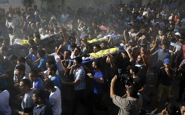 Palestinian mourners shout slogans during the funeral of four boys, all from the Bakr family, in Gaza City, on July 16, 2014. The four were killed and several others were injured at a beach in Gaza in an Israeli shelling. (photo credit: AFP/MOHAMMED ABED)