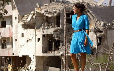 Lebanese actress Nada Abu Farhat in the southern Lebanese town of Sidiqin, during the shooting of 'Summer Rain' by Director Philippe Aractingi. Lebanon's civil war ended a quarter of a century ago but its filmmakers remain fixated on this dark period, seeing their movies as a kind of catharsis to help heal collective trauma. (photo credit: AFP photo/Patrick Baz)