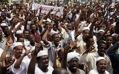 File: Sudanese men shout slogans during a protest against Israel's military operation in the Gaza Strip in the capital Khartoum on July 18, 2014. (photo credit: AFP/EBRAHIM HAMID)