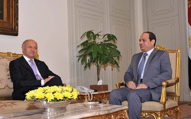 A handout picture released by the Egyptian Presidency on July 19, 2014, shows Egypt's President Abdel Fattah al-Sisi (R) meeting with French Foreign Minister Laurent Fabius in Cairo. (photo credit: AFP/ HO/EGYPTIAN PRESIDENCY)