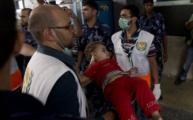 An injured Palestinian child arrives at Shifa hospital in Gaza City on July 20, 2014 (Photo credit: Mahmoud Hams/AFP)