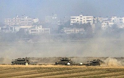 Illustrative. Israeli Merkava tanks fire at the Gaza Strip from inside Israel on July 20, 2014. (photo credit: AFP/JACK GUEZ)