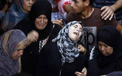Palestinian relatives of Hasan Baker, 60, grieve during his funeral in Gaza City, July 22, 2014. (photo credit: AFP PHOTO / MOHAMMED ABED)