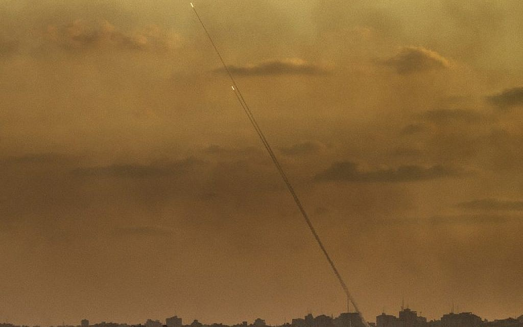 Illustrative. A picture taken from the southern Israeli Gaza border shows rockets being fired from the Gaza Strip into Israel, on July 24, 2014 (JACK GUEZ/AFP)