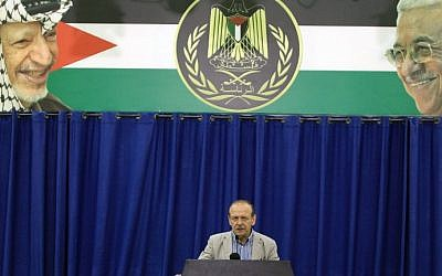 Yasser Abed Rabbo, Secretary General of the Palestine Liberation Organisation (PLO), announces that the Palestinian leadership along with Hamas and Islamic Jihad are willing to observe a 24-hour ceasefire in the war-torn Gaza Strip, during a press conference in the West Bank city of Ramallah on July 29, 2014. (photo credit: Abbas Momani/AFP)