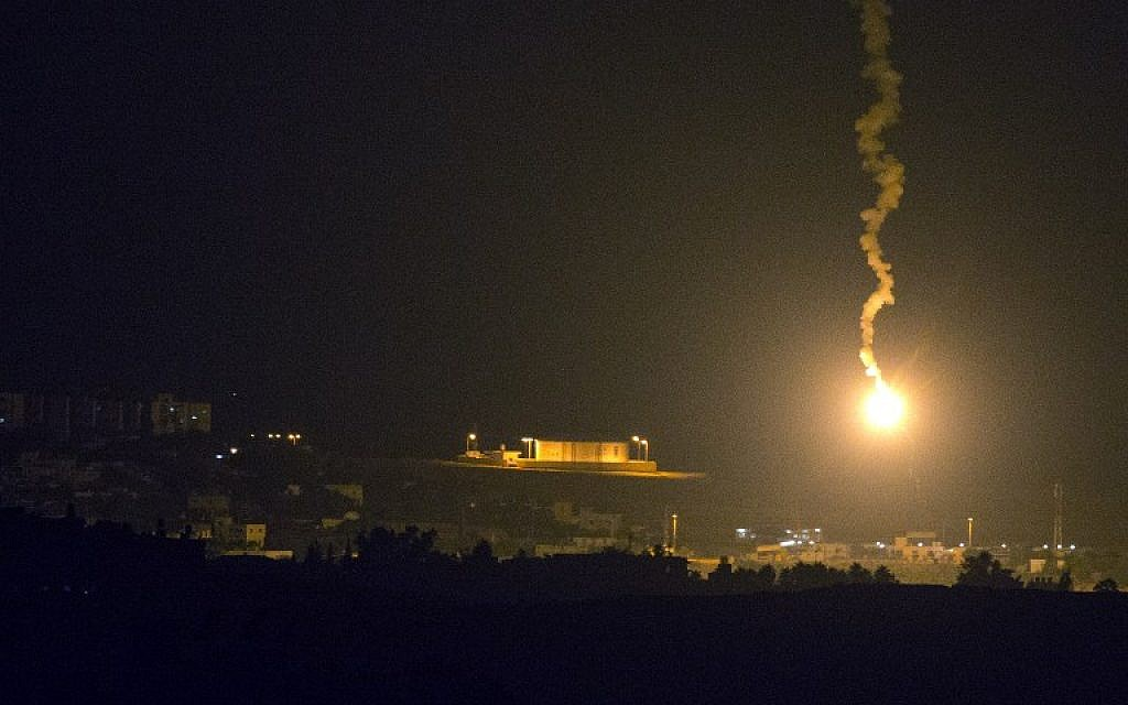 A picture taken from the southern Israeli border with the Gaza Strip shows Israeli flares illuminating the Palestinian coastal enclave, on July 7, 2014. (photo credit: AFP/JACK GUEZ)