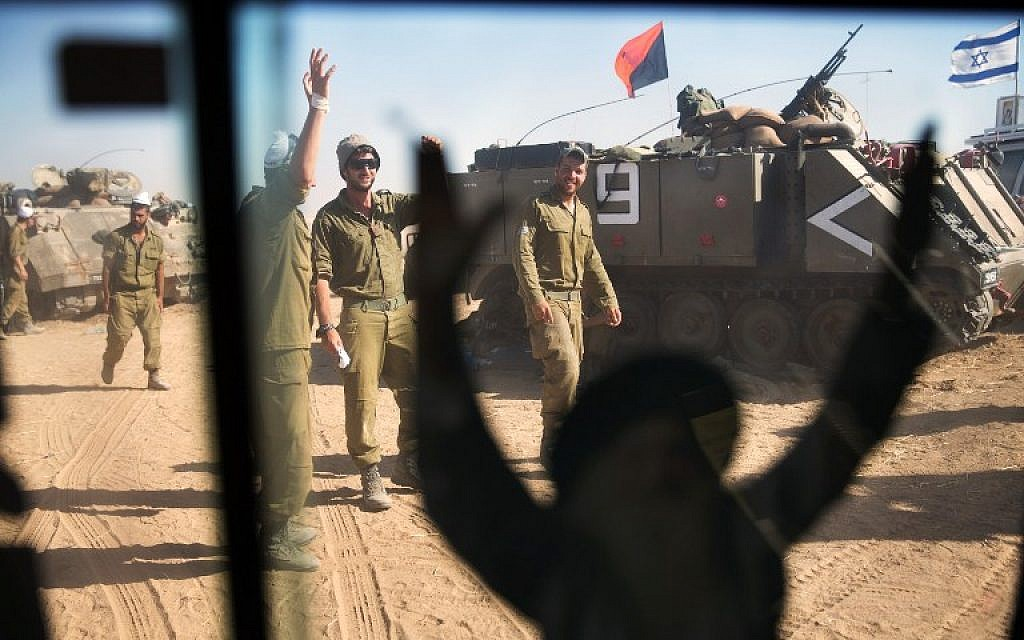 Israeli soldiers stand in a camp during an army deployment along Israel's border with the Gaza Strip on July 15, 2014. (photo credit:AFP/ MENAHEM KAHANA)