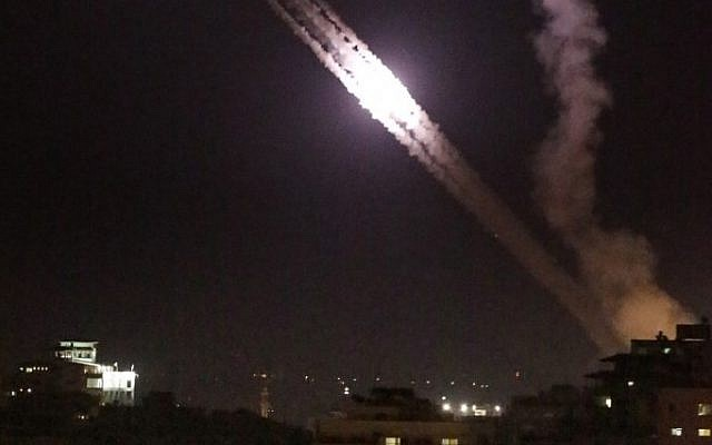 Illustrative: Palestinian missiles are fired from Gaza City toward Israel following Israeli airstrikes on July 17, 2014. (AFP/Thomas Coex)