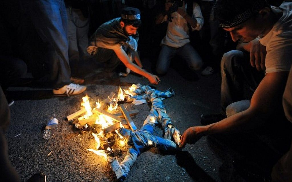 Turkish protestors set fire to a Star of David during a demonstration against the Israeli military operation in Gaza on Friday, July 18, 2014 in front of the Israeli Consulate in Istanbul. (photo credit: Ozan Kose/AFP)