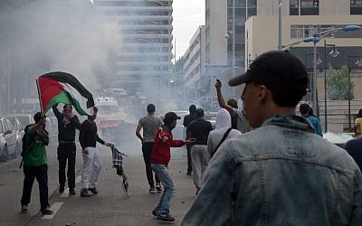 Protesters clash with riot police in Sarcelles, a suburb north of Paris, on July 20, 2014, during a demonstration to denounce Israel's military campaign in Gaza and show their support for the Palestinian people. (photo credit: AFP/Omar Bouyacoub)