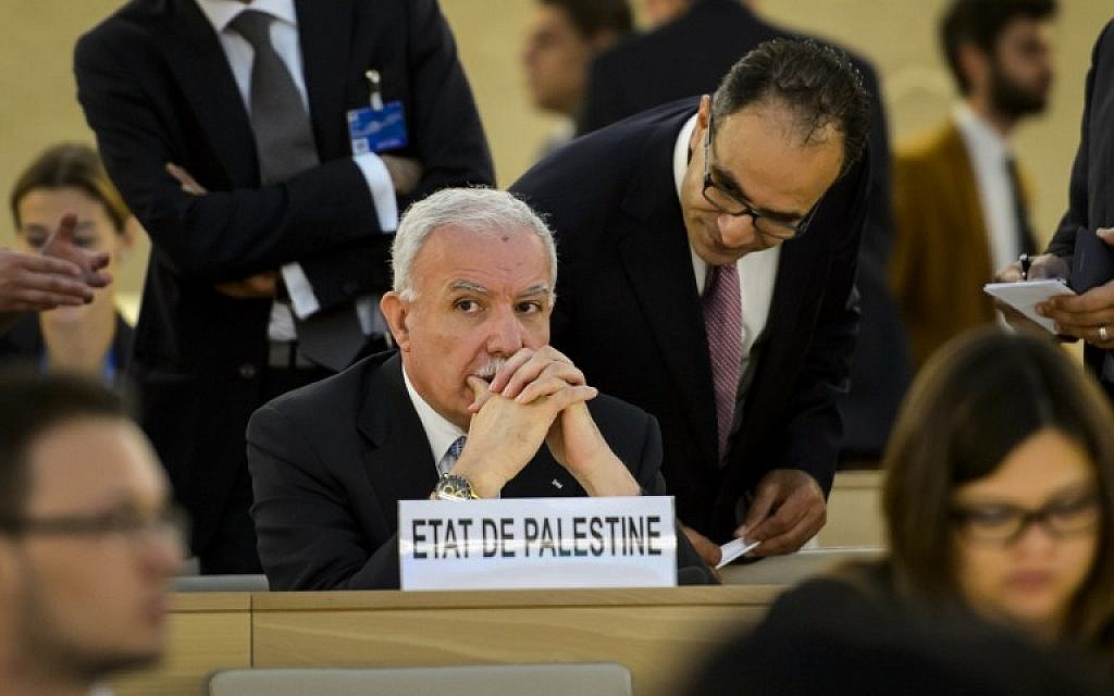 Palestinian Foreign Minister Riyad al-Maliki looks on prior to the start of an emergency session of the UN Human Rights Council on the Gaza crisis on July 23, 2014 at the United Nations Offices in Geneva (photo credit: AFP / FABRICE COFFRINI)