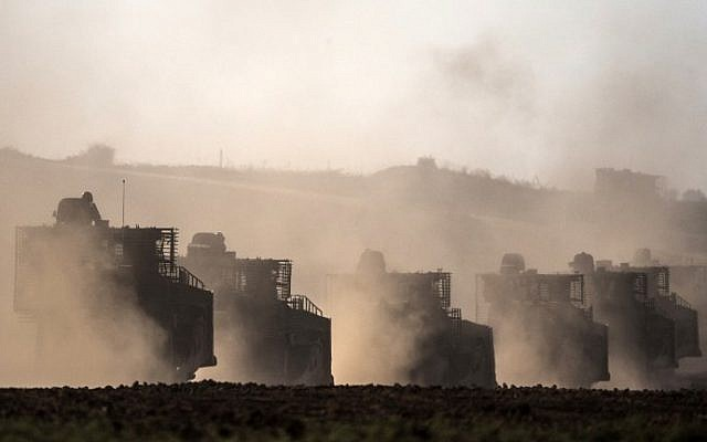 Israeli D9 bulldozers roll along the southern Israeli border with the Gaza Strip following Israeli airstrikes on the Gaza Strip on July 10, 2014. (photo credit: Jack Guez/AFP)