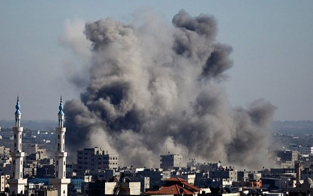 Smoke billows from buildings following an Israeli air strike on Gaza City on July 11, 2014. (photo credit: Mohammed Othman/AFP)