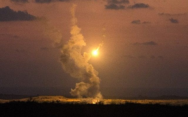 A picture taken on July 14, 2014 from the southern Israeli Gaza border shows Israeli army flares falling into the Palestinian enclave. (photo credit: Jack Guez/AFP)