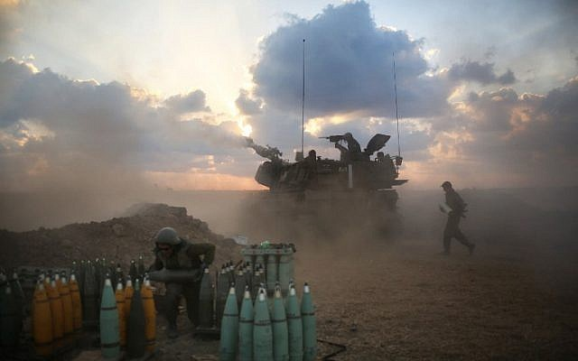 Israeli soldiers fire towards the Gaza Strip from their position near Israel's border with the coastal Palestinian enclave on July 19, 2014. (photo credit: AFP/MENAHEM KAHANA)