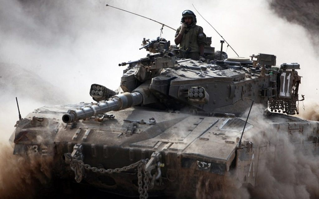 An IDF Merkava tank rolls along the border between Israel and the Hamas-controlled Gaza Strip on Monday, July 28, 2014 (AFP/DAVID BUIMOVITCH)