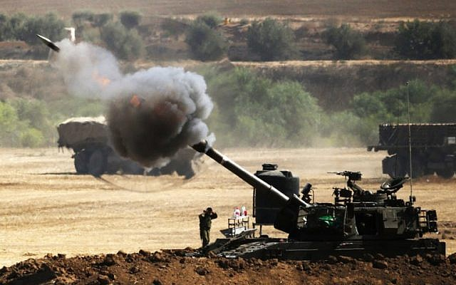 File: An Israeli artillery gun fires a 155mm shell towards targets from their position near Israel's border with the Gaza Strip on July 30, 2014. (photo credit: AFP/ JACK GUEZ)