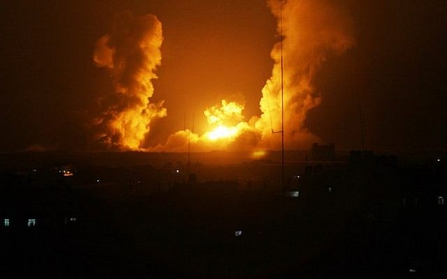 A ball of fire is seen after an Israel airstrike on Rafah, southern Gaza, on July 1, 2014. (photo credit: AFP/Said Khatib)