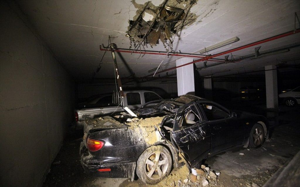 Damage caused by a missile strike in Ashdod on July 8,  2014. (photo credit: AFP/DAVID BUIMOVITCH)