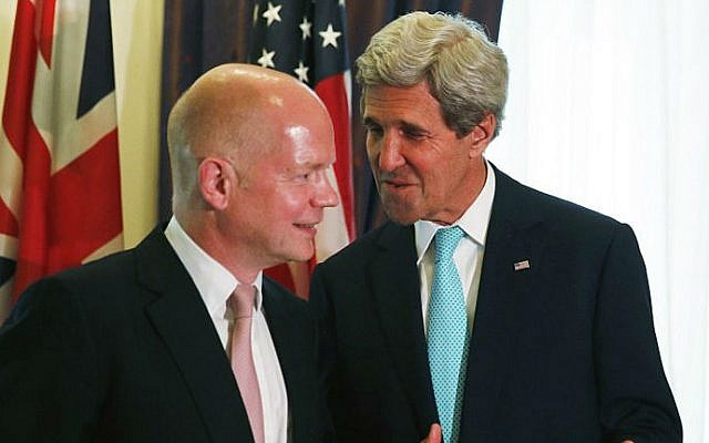 British Foreign Secretary William Hague (L) talks with US Secretary of State John Kerry (R) during a bilateral meeting during talks between the foreign ministers of the six powers negotiating with Tehran on its nuclear program, in Vienna, on July 13, 2014. (photo credit: JIM BOURG/POOL/AFP)