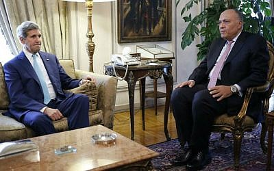 US Secretary of State John Kerry meets with Egypt's Foreign Minister Sameh Shukri in Cairo on July 22, 2014. (photo credit: AFP)
