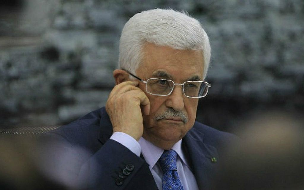 Palestinian Authority President Mahmoud Abbas at a meeting in the West Bank city of Ramallah with members of the Palestine Liberation Organization (PLO), July 22, 2014. (AFP/Abbas Momani)