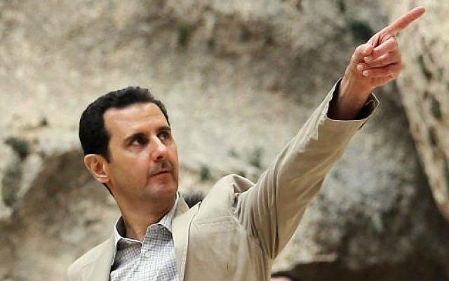 Syrian President Bashar al-Assad visiting troops, April 20, 2014. (AFP/HO/SANA)