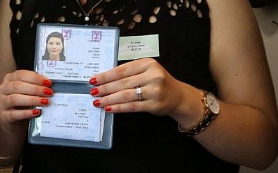 New olah Becky Kupchan showing her Teudat Zehut (Israeli citizenship card) after her arrival in Israel on Tuesday, July 8, 2014.