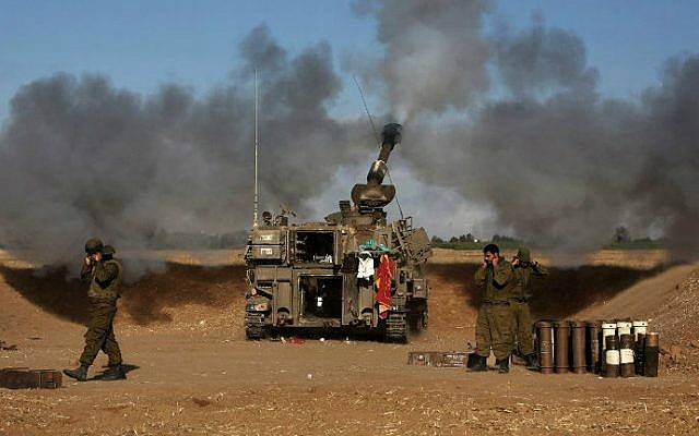 A 155mm artillery tank, positioned near the Israeli border with the Gaza Strip, fires a projectile towards targets in the Palestinian enclave, on July 17, 2014 (photo credit: AFP/Menahem Kahana)