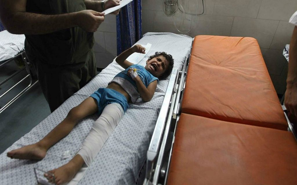 A wounded girl is treated at the emergency room of the Shifa hospital in Gaza, Friday, July 18, 2014 (photo credit: Emad Nassar/Flash90)