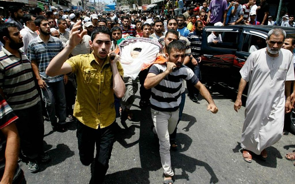 Palestinians carry the body of a Hamas operative, who medics said was killed by an Israeli air strike which took place before a five-hour humanitarian truce, during his funeral in Rafah in the southern Gaza Strip on July 17, 2014 (photo credit: Abed Rahim Khatib/Flash90)