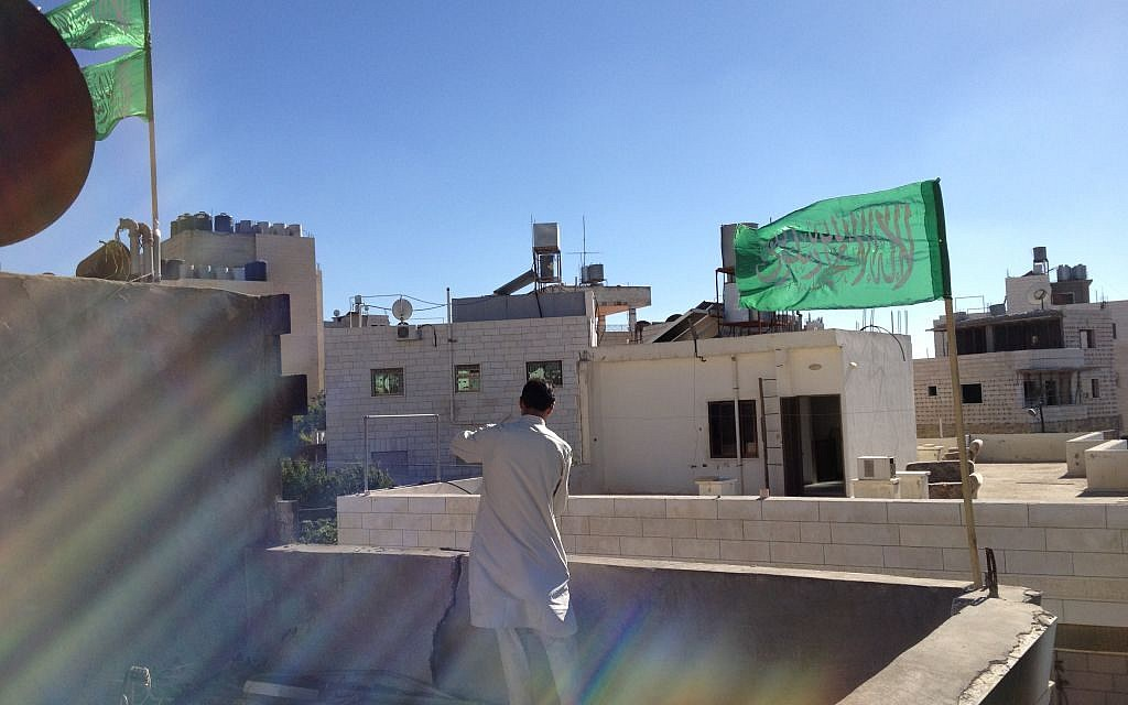 The rooftop of the Kawasme home in Hebron, where a Hamas flag was placed on Tuesday, July 1, 2014 (photo credit: Elhanan Miller/Times of Israel)