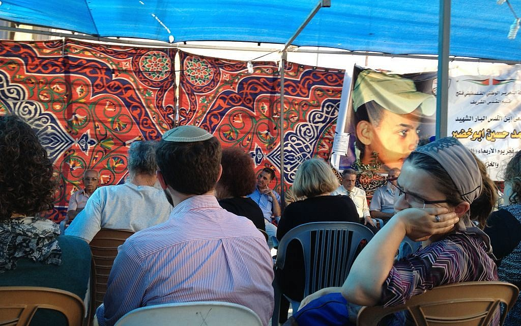Israeli visitors at the mourners' tent of the Abu Khdeir family in Shuafat, Jerusalem, July 8, 2014 (photo credit: Elhanan Miller/Times of Israel)