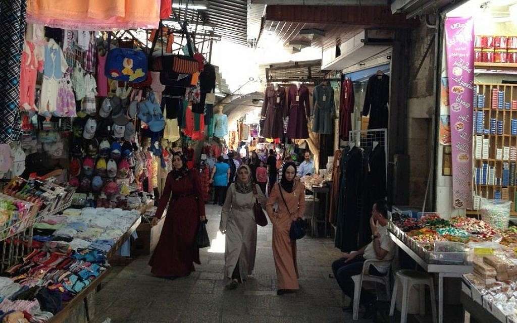 Palestinian women walk through the Old City of Jerusalem, July 13, 2014 (photo credit: Elhanan Miller/Times of Israel)