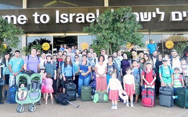 A group of 64 immigrants who arrived in Israel on Tuesday, July 8, 2014, after the commencement of Operation Protective Edge in the Gaza Strip. (photo credit: Sasson Tiram/Nefesh B'Nefesh)