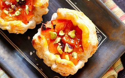 Fresh apricots, jam and pistachio pieces in a homemade pastry (photo credit: Andrea Brownstein/Photoli Photography)
