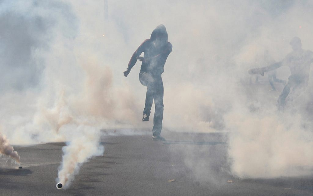 Smoke bombs are set off during the Saturday July 26, 2014 protest in Paris. (Glenn Cloarec/The Times of Israel)