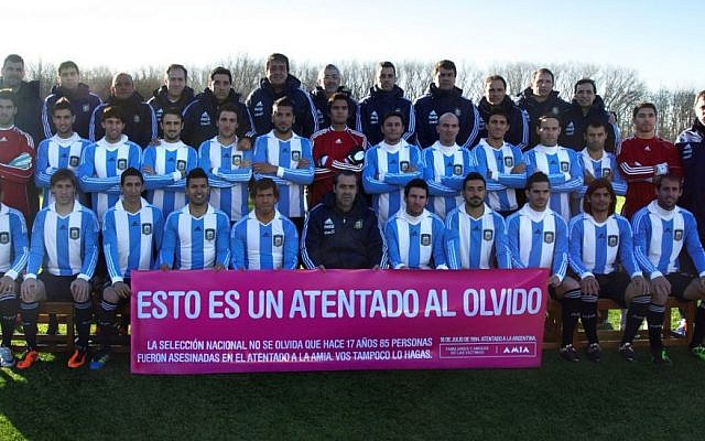 Players from Argentina's national soccer team holding up a banner commemorating victims of the 1994 AMIA bombing. (JTA)