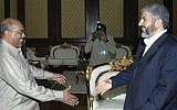 Then-Hamas chief Khaled Mashaal, right, meets with then-Sudanese president Omar Al-Bashir in Khartoum, Sudan, August 2008. (AP/Abd Raouf)