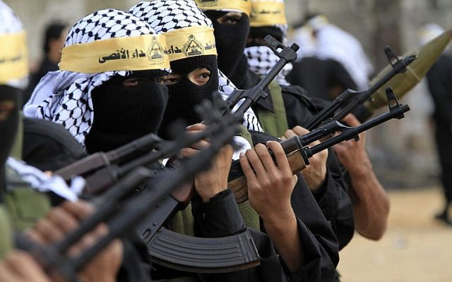 Masked Palestinian Fatah fighters from the Al-Aqsa Martyrs Brigades parade during a rally marking the 46th anniversary of the movement's creation, in the Palestinian refugee camp of Ein el-Hilweh, near the southern port city of Sidon, Lebanon, December 31, 2010. (AP Photo/Mohammed Zaatari/File)