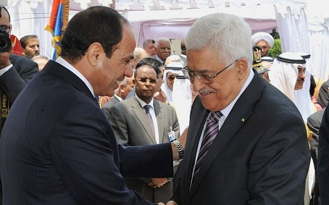 Egyptian President Abdel-Fattah el-Sissi, left, greets Palestinian Authority President Mahmoud Abbas during his inauguration ceremony at the presidential palace in Cairo, Egypt, on June 8, 2014. (AP/MENA)